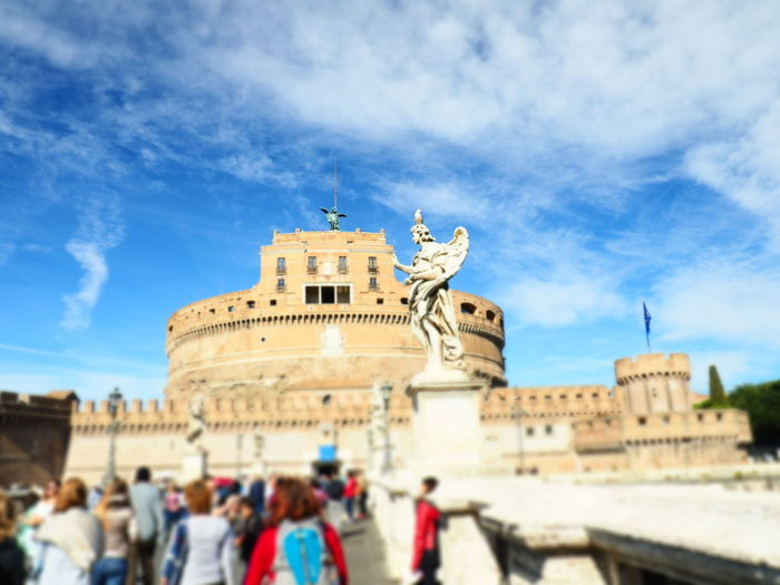 Castel Sant'Angelo Rome Architecture Blue Building Exterior Built Structure City Cloud - Sky Day History Large Group Of People Low Angle View Outdoors Real People Sculpture Sky Statue Tourism Travel Travel Destinations
