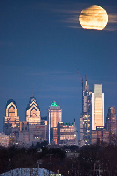 Lunar Eclipse, Super Blue Moon setting on Philadelphia skyline right before Superbowl LII. Philadelphia Skyline was lit in green leading up to the event. Lunar Eclipse Moon Philadelphia Philadelphia Eagles Skyline Blood Moon Blue Moon Moon Set Supermoon