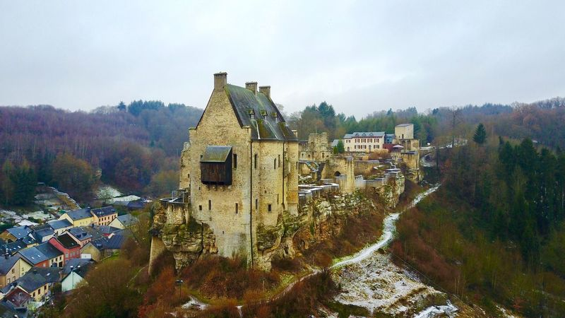 Castle Ruins of Larochette, LU Built Structure Building Exterior Tree No People House High Angle View Sky Outdoors Day Religion Country House Mountain Nature Castle Larochette Luxembourg Ruins History Müllerthal DJI Mavic Pro Dji Drone  Ski Lift