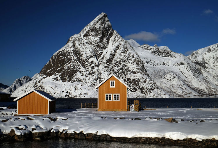 Lofoten Islands, Norway Norway Paint The Town Yellow Winter Architecture Beauty In Nature Building Exterior Built Structure Clear Sky Cold Temperature Day House Landscape Lofoten Mountain Mountain Range Nature No People Outdoors Scenics Sky Snow Snowcapped Mountain Tranquility Winter