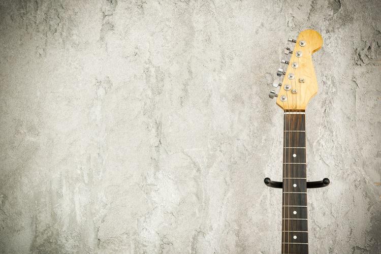 Yellow guitar on wall