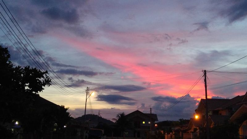 Took this outside my house in our neighbourhood. Decided to use it as my phone`s wallpaper because of the beautiful color. My brother couldn`t believe this was near our home. 😂 l home Lahad Datu Sabah Malaysia l 23rd July 2016 l 06:40:24 PM l Sky Evening Sky Clouds And Sky Evening