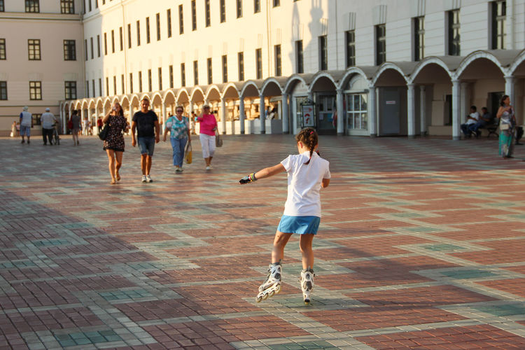 """Skating away"" Adult Architecture Casual Clothing Child Day Evening Light Full Length Girl Inline Skating Kazan Kid Little Girl Outdoors People Public Real People Russia Skating Snap A Stranger Sport Square Street Streetphotography Vacations"