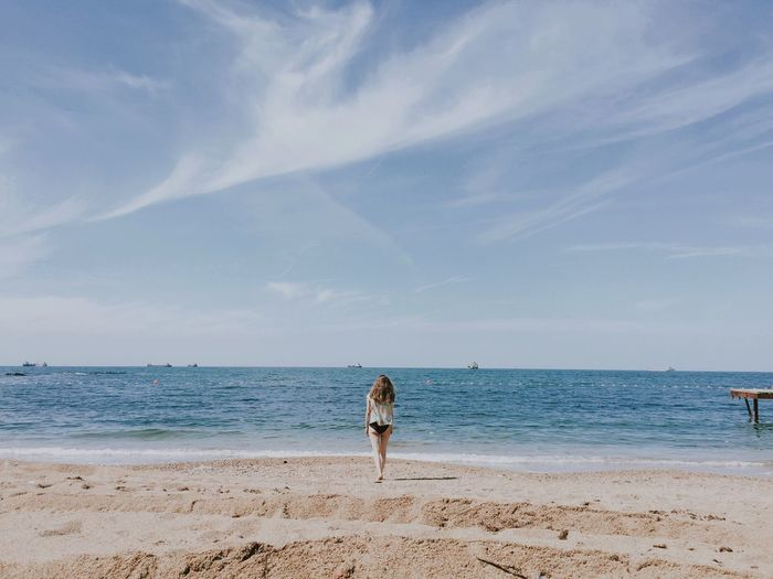 There you are Beach Sea Water Land Sky Sand Horizon Over Water Horizon Day Nature Outdoors Tranquil Scene One Person Beauty In Nature Cloud - Sky Real People
