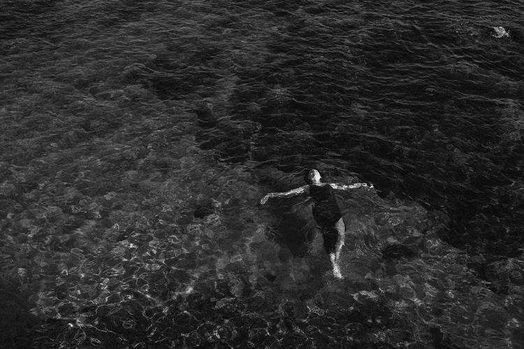 High angle view of man standing in sea
