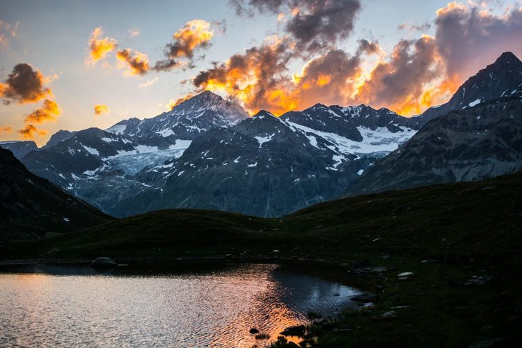 Swiss Alpenglow Mountain Sky Scenics Tranquil Scene Nature Cloud - Sky Sunset Mountain Range Beauty In Nature Water Snow Reflection Landscape Tranquility Lake Idyllic Outdoors No People Day Scenery Sunlight Sunset #sun #clouds #skylovers #sky #nature #beautifulinnature #naturalbeauty #photography #landscape Switzerland Swiss Alps