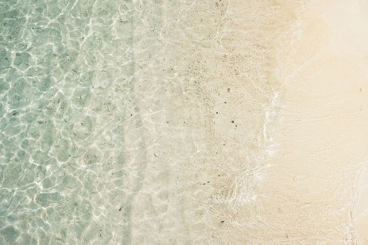 Close up of footprints on the beach sand at the golden hour. Asian  Bay Beach Beautifully  Blue Bright Caribbean Clear Coast Color Crystal Destination Dinghy Famous Green Holiday Island Lagoon Malaysia Mediterranean  Nature Nobody Ocean Outdoor Paradise Picturesque Rawa Relax Sand Scenery Scenic Sea Seascape Sky Summer Sunlight Sunny Sunshine Tourism Tranquil Travel Tropic Tropical Turquoise Vacation View Water White