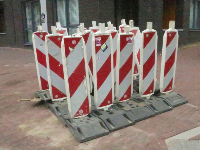 in company Sign Red Striped No People In A Row Day Arrangement Street Traffic Sign Still Life Group Of Objects