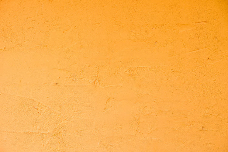 Architecture Backgrounds Beige Built Structure Close-up Copy Space Day Dirt Full Frame Nature No People Orange Color Outdoors Paint Pattern Plaster Sunlight Textured  Wall - Building Feature Yellow