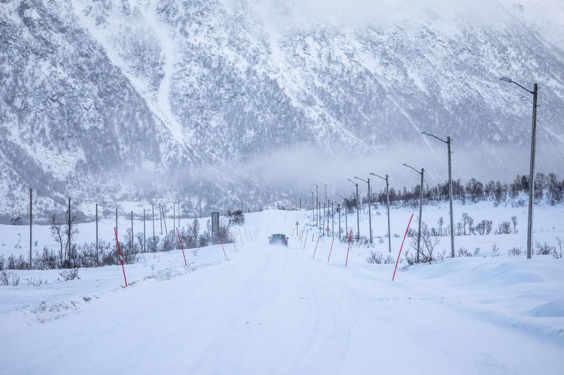Scenic View Of Snow Covered Road