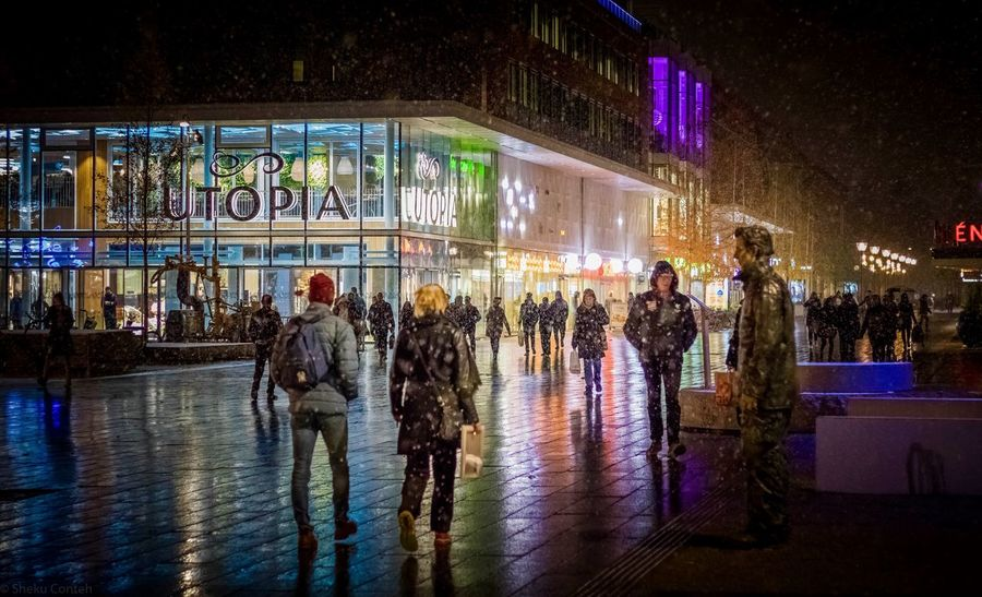Colorful Evening Umeå Sweden Christmas Time Night Architecture Group Of People Built Structure Building Exterior Illuminated The Photojournalist - 2018 EyeEm Awards City Real People Crowd Large Group Of People Men Street City Life Reflection Outdoors Nightlife