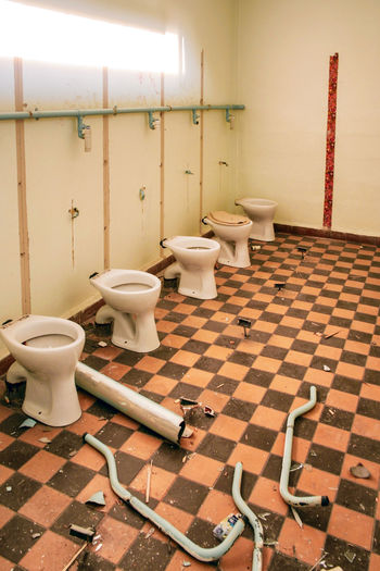 125. POS Dresden GDR Abandoned School Bathroom Flooring Tile Indoors  Tiled Floor Toilet Domestic Room Home Domestic Bathroom Toilet Bowl No People Hygiene Absence Household Equipment Seat Wall - Building Feature Home Interior Day Sink Public Restroom Clean Crockery