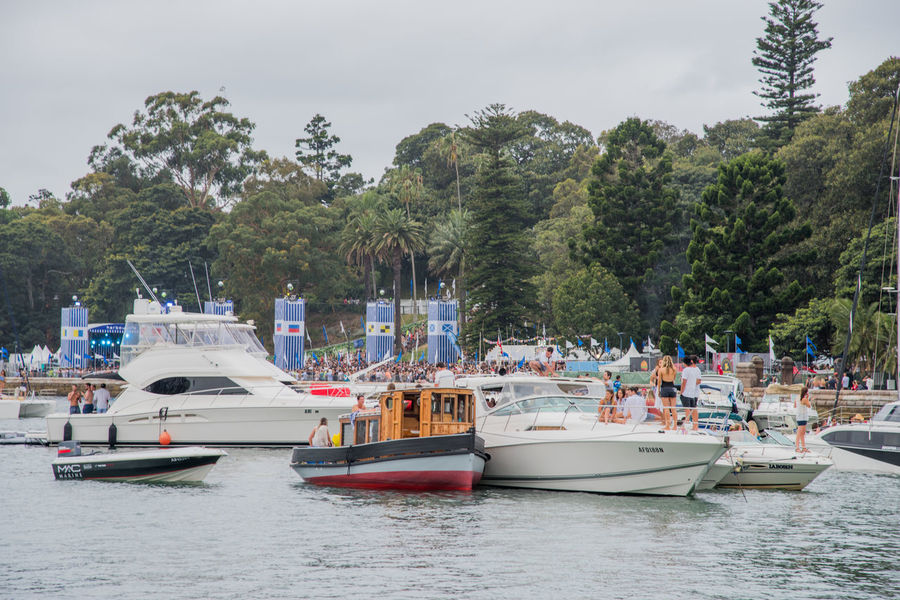 Sydney,NSW,Australia-November 19,2016: Tourists and nautical vessels gathering in Farm Cove during The Plot 2016 music festival at Parrametta Park in Sydney, Australia. 2016 Australia Fun Harbour Inlet Music Stage The Plot Tourists Transportation Boat Entertainment Farm Cove Fest Group Of People Leisure Activity Music Festival Nautical Vessel Real People Social Gathering Speedboat Stage - Performance Space Sydney Yacht Young Adult