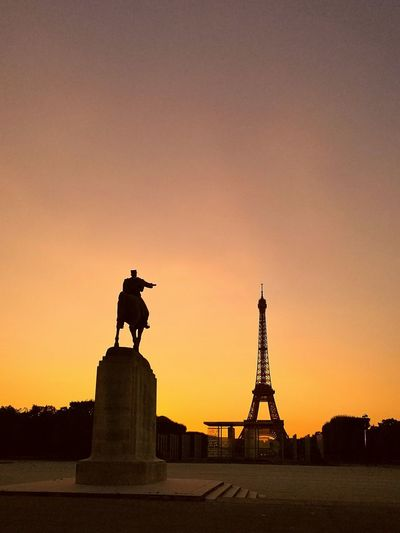 Eiffel tower sunset Statue Silhouette Sunset Travel Destinations Orange Color Outdoors In Front Of National Landmark Tourism Sky No People History Pedestal Creativity Monument Famous Place Built Structure Architecture Sculpture France France 🇫🇷 Toirism Tourism Destinationfirst world war International Landmark Tourist WWI