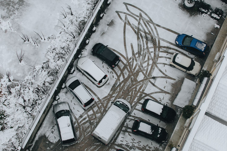 High angle view of cars parked at parking lot during winter