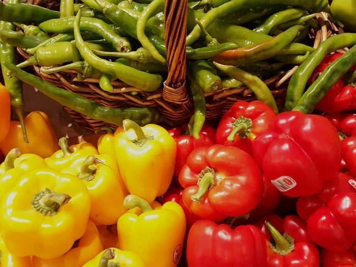 Close-up of bell peppers and chilies for sale