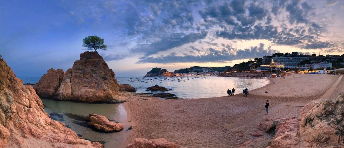 Tossa de Mar Water Beach Land Sea Sky Scenics - Nature Sand Cloud - Sky Nature Rock Formation Outdoors Panoramic Beauty In Nature Rock - Object Rock Incidental People Tranquil Scene
