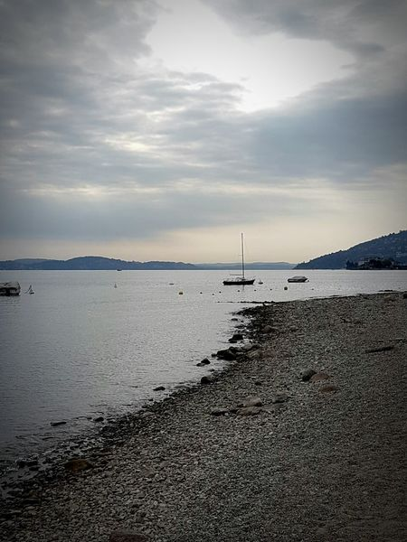 Beach Landscape Tranquility Water Dramatic Sky Cloud - Sky SkyLast Moments Of Summer Landscapes Beauty Italia Lago Maggiore Lago Maggiore, Italy Laggomaggiore Italy Horizon Over Water Beauty In Nature Nature Vacations Travel Destinations Day Scenics No People Nature Mountains