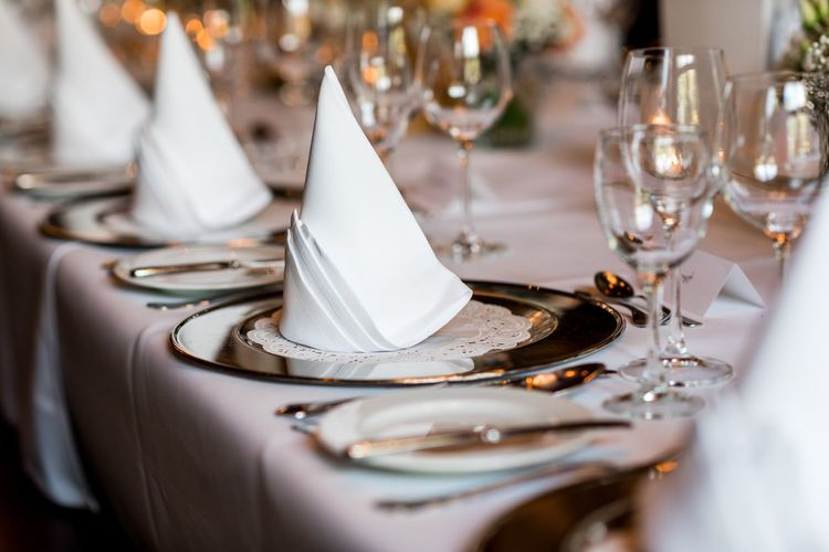 Close-Up Of Place Setting On Dining Table