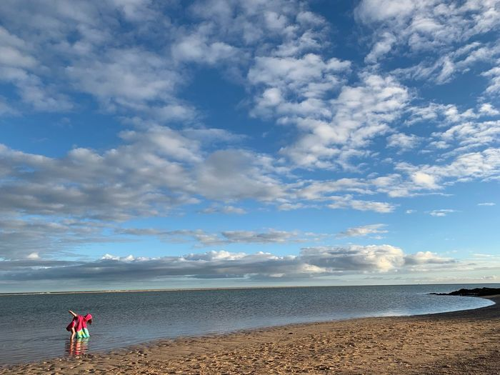 Sea Beach Sky Cloud - Sky Water Land Beauty In Nature Horizon Over Water Nature One Person Tranquility Horizon Scenics - Nature Holiday Leisure Activity Tranquil Scene Sand Day Outdoors Pebble