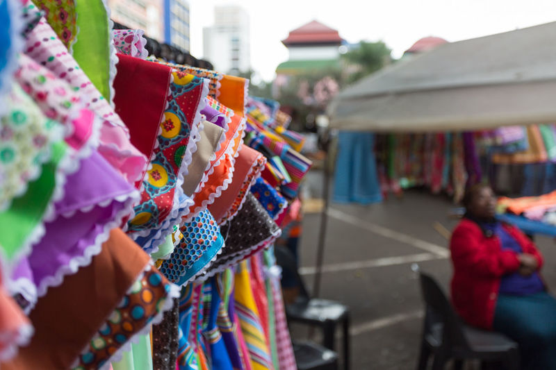 Close-Up Of Colorful Dresses In Market