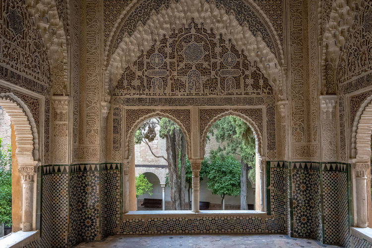 interior of Alhambra, Granada, Spain Alhambra Alhambra De Granada  Interior Spain Architecture SPAIN Arabic Style Architecture Arch Built Structure The Past History Travel Destinations Architectural Column No People Day Window Indoors  Travel Plant Tourism Old Building Nature Tree Ornate Courtyard  Luxury