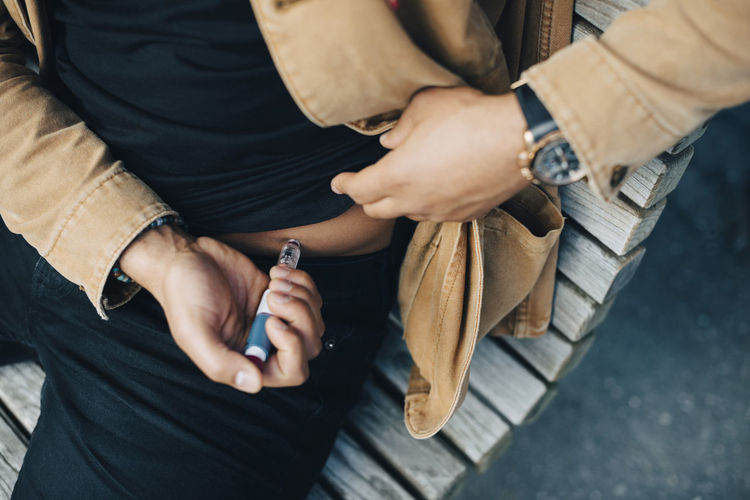 High angle view of man smoking cigarette