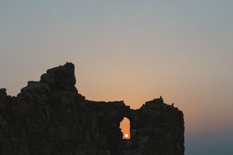 Dawn in Metzada. Perspectives On Nature Adventure Beauty In Nature Day Israel Metzada Nature Old Buildings Old Palace Palace Rock - Object Rock Climbing Scenics Silhouette Sky Sun Sunset Window Window View Windows