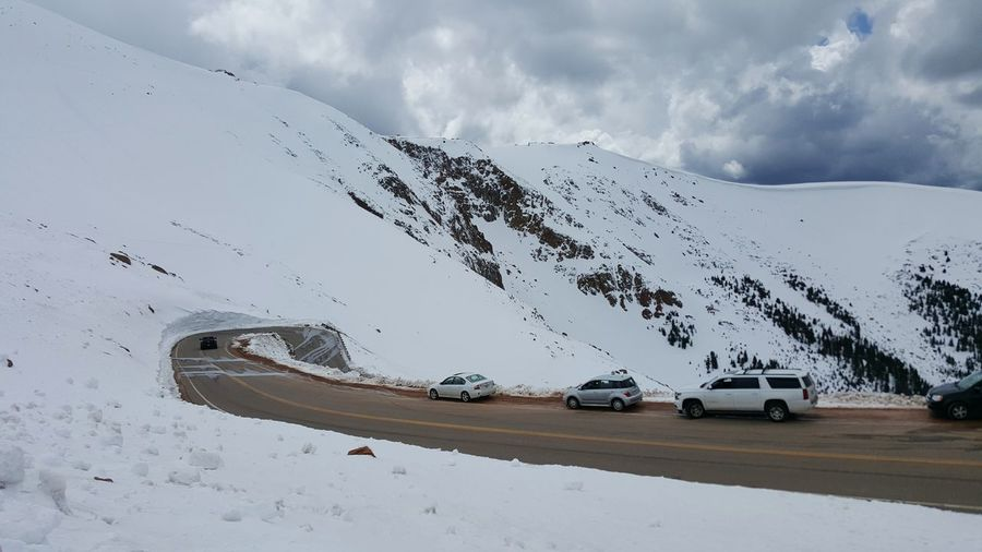 Pikes Peak Highway , Colorado Springs , Colorado . May2015. Spring Snow Winter Alpine Alpine Road Hairpin Turns High Elevation Driving Adventure Steep Mountain Rocky Mountains