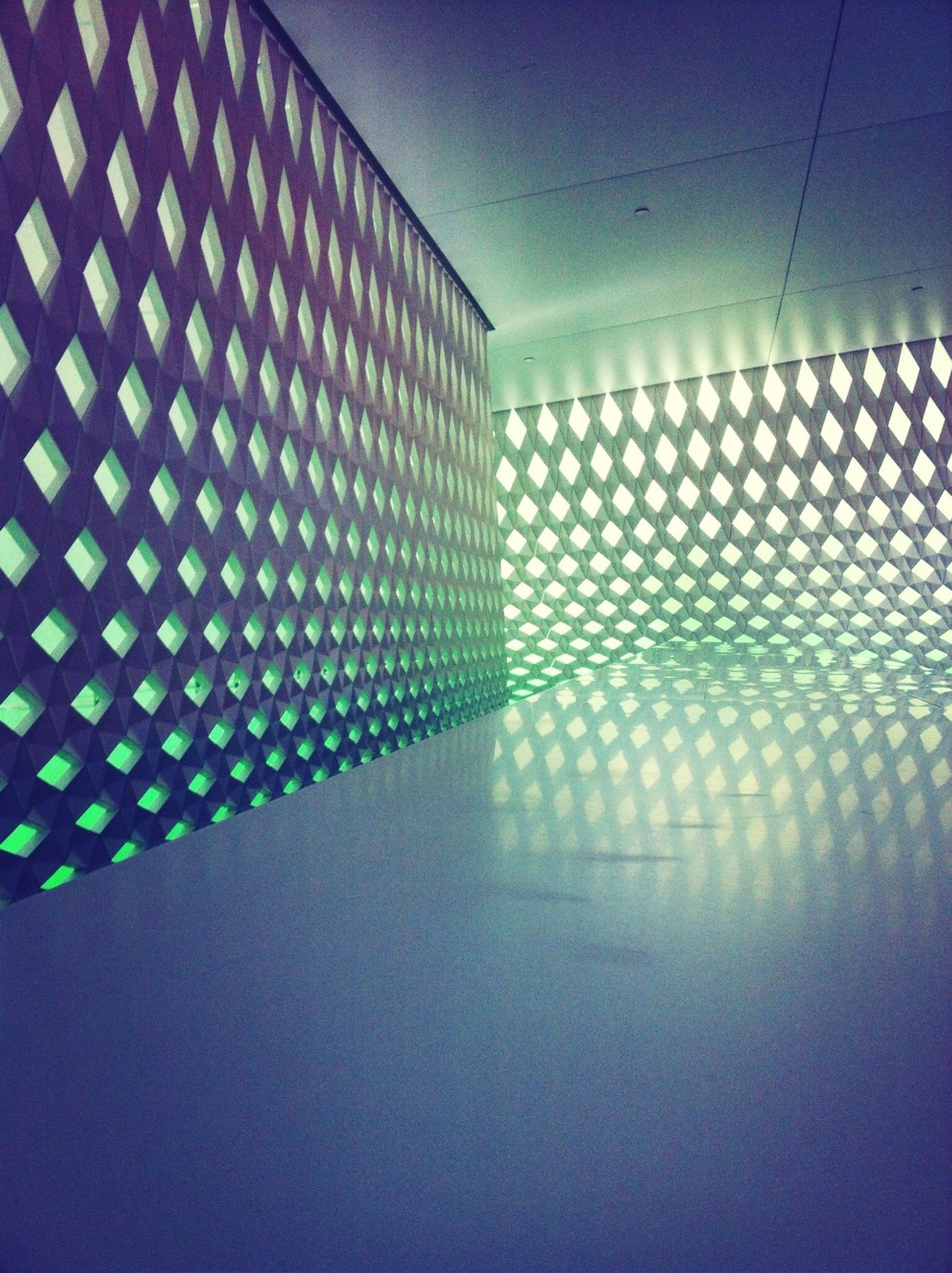 indoors, wall - building feature, architecture, ceiling, built structure, illuminated, pattern, lighting equipment, wall, blue, flooring, home interior, no people, window, empty, absence, tile, reflection, modern, light - natural phenomenon
