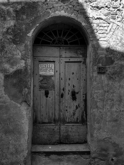 """vendisi"" Italy Italia Toscana Tuscany Montefollonico Architecture Detail Blackandwhite Shadow And Light Shadow Door Doorway Entrance Closed Architecture Close-up Built Structure Building Exterior Closed Door Wooden Locked Front Door"