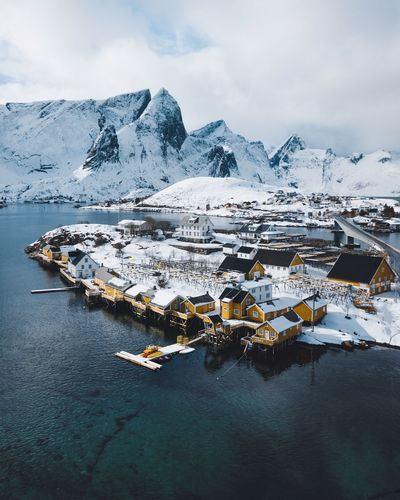 Sakrisøy from above Water Beauty In Nature Sky Scenics - Nature Cold Temperature Snow Winter Tranquil Scene Nature Tranquility Landscape Cloud - Sky Sea Mountain Land Non-urban Scene Environment No People Snowcapped Mountain Outdoors