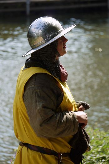 Armour Battle Reenactment Focus On Foreground Helmet Medieviltimes Riverbank Side View Water Yellow