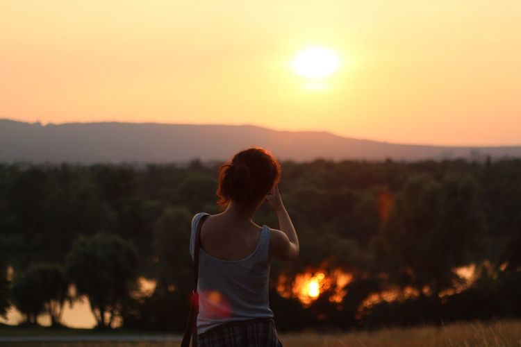 Sunset Real People Rear View Lifestyles Orange Color Leisure Activity Outdoors One Person Focus On Foreground Women Beauty In Nature Sky Standing Young Women Scenics Tree Young Adult Sports Clothing Day