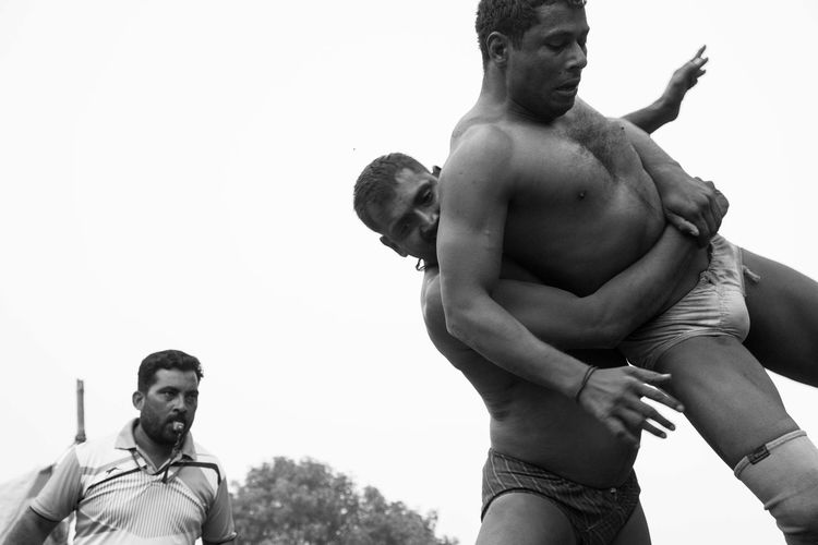 Dangal, also known as Kushti, is an Indian form of wrestling played in mud. It is still popular form of entertainment and spoort in smaller towns and villages in India. Pictured here is a local competition held in a popular fair in Deva, Barabanki, India. Dangal India Indian Wrestling Kushti Sports Street Photography Streetphotography The Street Photographer - 2017 EyeEm Awards Wrestling Been There. Done That. Be. Ready. This Is Masculinity