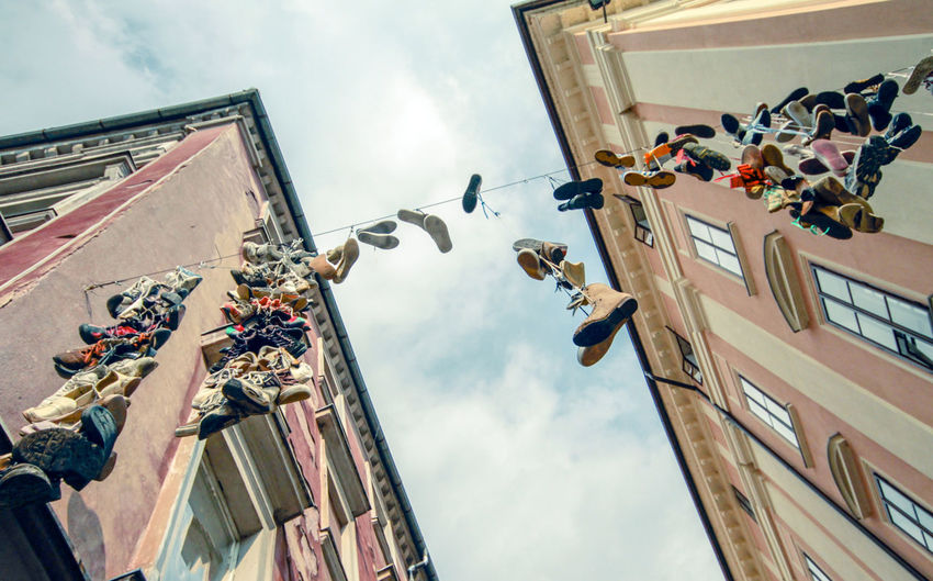 Fun Retro Scene Shoes Sneakers Hang Urban Vintage City Old Wire Buildings Footwear Fashion Europe Dirty Dangling Cable Concept Funny Destination Lifestyle Street Tourism Tourist Varazdin Vacation Travel Slippers Lost LINE Outdoors Pair Grunge Trainers Gritty Life Living Clothing Strings Neighborhood Place Sky Looking Up