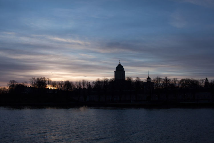 Water Sky Built Structure Cloud - Sky Architecture Building Exterior Waterfront Building Nature No People Sunset Dusk Tree Plant Place Of Worship Belief Travel Destinations Outdoors Spire  Suomenlinna