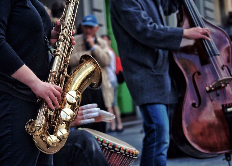 Midsection of musicians performing on street