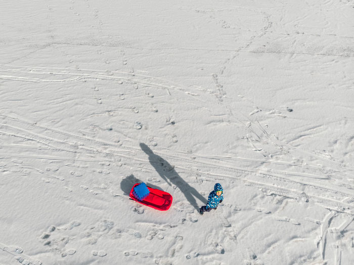 High angle view of person skiing on snowy field