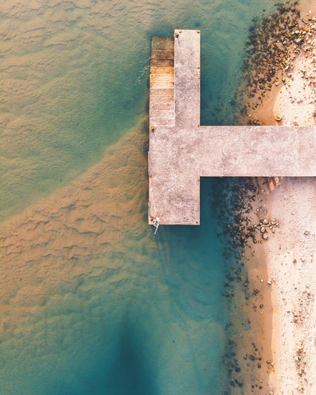 Aerial view of pier at shore