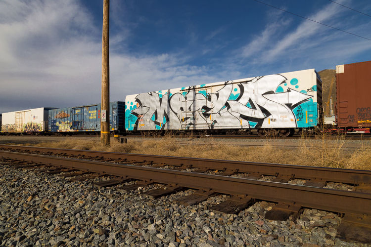 Architecture Built Structure Cloud - Sky Day Graffiti M. Leith: Train Car Project Megas No People Outdoors Rail Transportation Railroad Track Sky Spray Art Spray Paint Taken By M. Leith Transportation The Street Photographer - 2017 EyeEm Awards