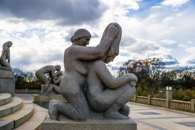 Vigeland Sculpture Park Vigeland Sculpture Park Art Art And Craft Carving - Craft Product Cloud - Sky Craft Creativity Famous Place Fountain Human Representation Memorial Monument Oslo Sculpture Sky Statue Stone Material Travel Destinations Tree