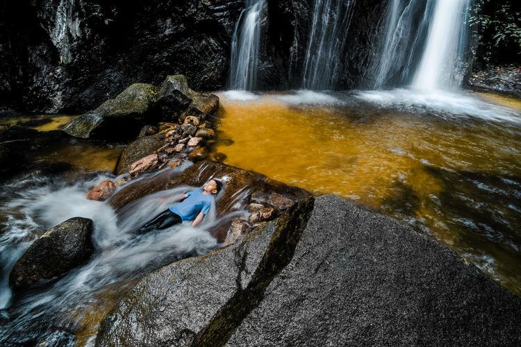 Boy enjoying waterfall