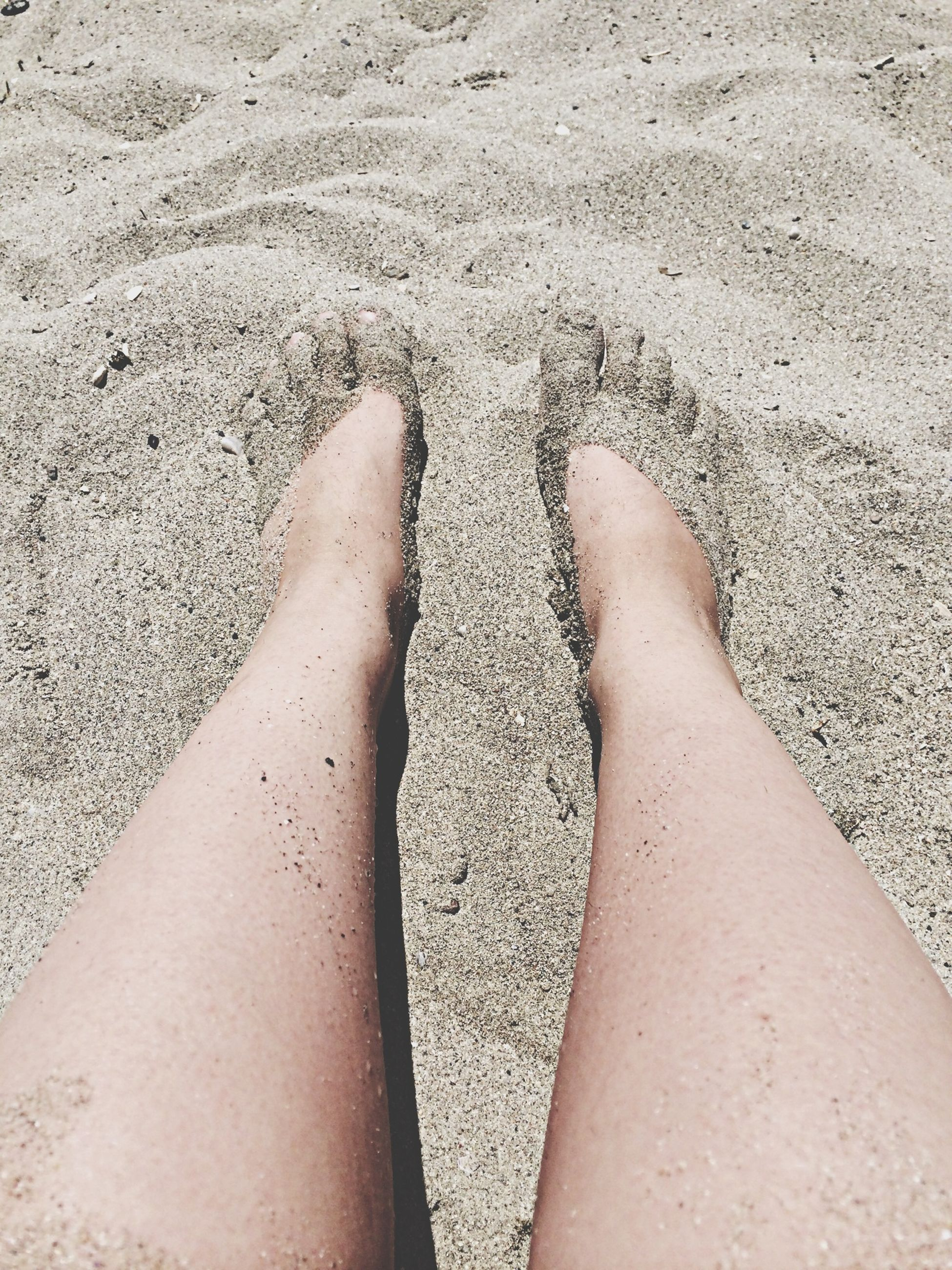 low section, person, personal perspective, human foot, barefoot, high angle view, lifestyles, leisure activity, sand, beach, sunlight, shadow, part of, standing, shoe, day