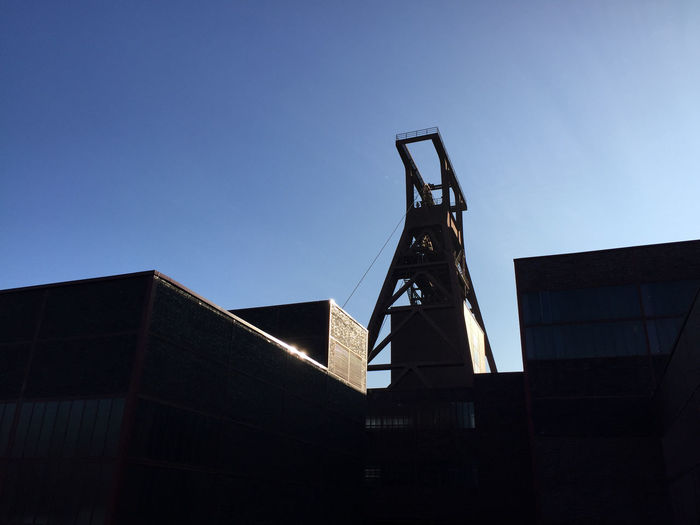 Low Angle View Of Zollverein Coal Mine Industrial Complex Against Sky