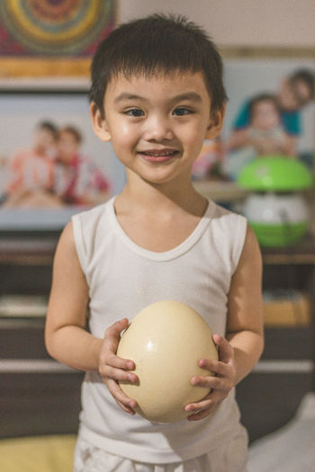 My son holding an ostrich egg... ostrich egg Ostrich egg Looking At Camera childhood focus on foreground front view portrait one person indoors child smiling food holding real people waist up Food and Drink lifestyles healthy eating girls Males Innocence Eyeem Philippines The Week on EyeEm Kids Of EyeEm Ostrich Egg Ostrich Egg Looking At Camera Childhood Focus On Foreground Front View Portrait One Person Indoors  Child Smiling Food Holding Real People Waist Up Food And Drink Lifestyles Healthy Eating Girls Males  Innocence Eyeem Philippines