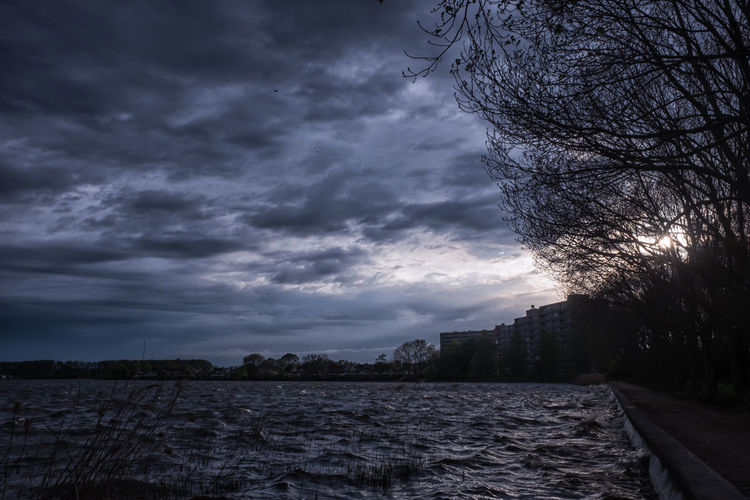 Zegerplas - 1 Sky Cloud - Sky Tree Nature No People Scenics - Nature Overcast Water Tranquility Beauty In Nature Plant Tranquil Scene Outdoors Non-urban Scene Dusk Environment Landscape Storm Dark Ominous