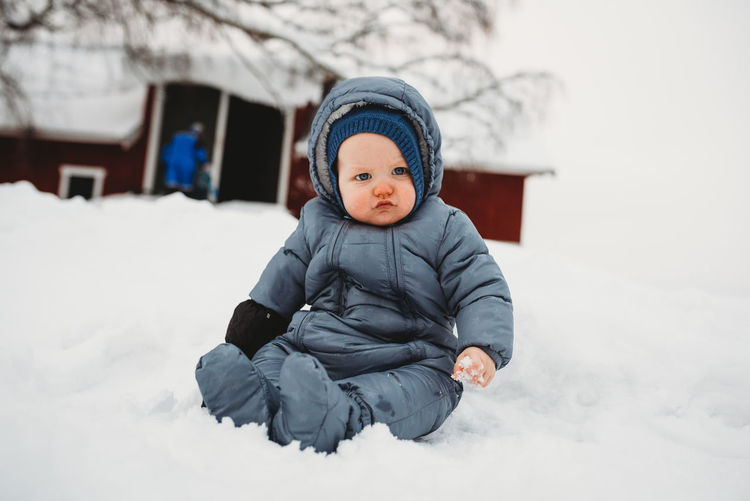 Full length of cute baby girl in snow