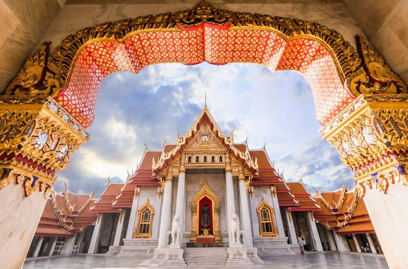 Low angle view of wat benchamabophit seen from entrance archway