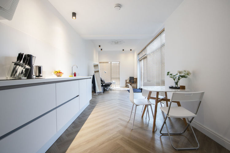 Indoors  Domestic Room Home Interior Home Table Flooring Furniture No People Absence Seat Home Showcase Interior White Color Chair Modern Empty Lighting Equipment Architecture Day Domestic Kitchen Building Luxury Tiled Floor Ceiling